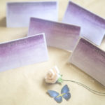 watercolor snow purple flower pastel colors butterfly logo zayeneesha samina farooq photography