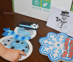 crowdfunded islamic project, subscription box for muslim kids, muslim homeschooling, muslim homeschooler, product photography of a box, box green logo, islamic pattern product, science for muslim children, halal edutainment for kids, islam for young minds, snowman craft
