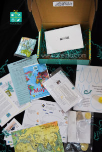 maps, compass, crowdfunded islamic project, subscription box for muslim kids, muslim homeschooling, muslim homeschooler, product photography of a box, box green logo, islamic pattern product, science for muslim children, halal edutainment for kids, islam for young minds