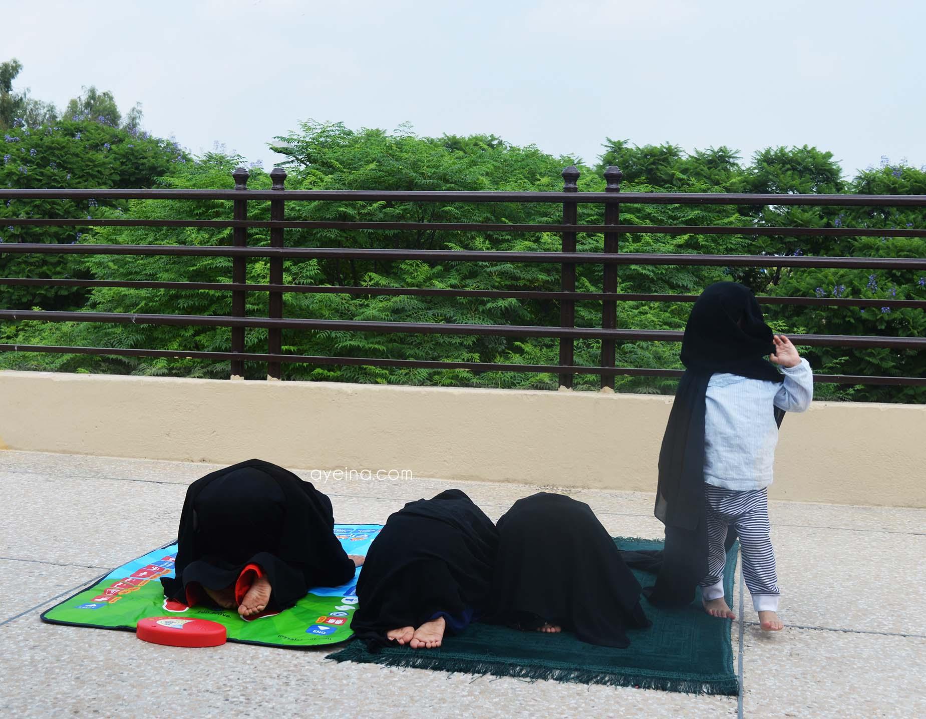 my salah mat kids on rooftop greenery trees pray together stay muslimah hijab